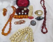 Assorted costume jewellery including shirt studs, bead necklaces, bracelets etc