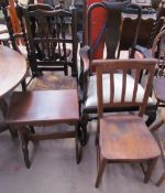 A Queen Anne style mahogany elbow chair together with a spindle back dining chair, a church chair