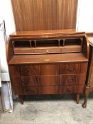 A reproduction mahogany cylinder bureau with three graduated drawers