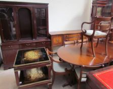 A Bevan Funnel extending dining table and eight chairs together with a wall unit,