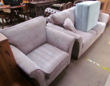 An upholstered two seater settee together with a matching arm chair and a footstool
