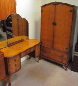 A 20th century burr walnut wardrobe and matching dressing table
