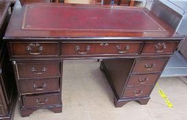 A reproduction mahogany pedestal desk,