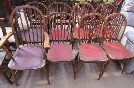 A set of four stick back dining chairs (includes a carver) together with a set of four wheel back