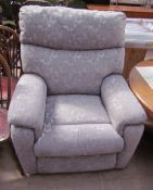 A Timotion TP2 reclining chair in a grey floral fabric