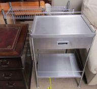 A stainless steel kitchen side table with a drawer and shelf together with a stainless steel