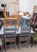 A painted pine kitchen table together with a set of four ladder back dining chairs,