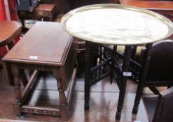 A brass topped occasional table on an ebonised folding base together with an oak occasional table