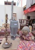 A gilt metal candlestick table lamp together with a developer and a doll