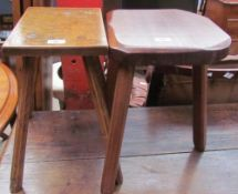 An elm seated stool on four tapering legs together with a three legged stool