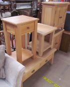 A 20th century limed oak coffee table together with a pair of side cabinets an occasional table and