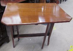 An Edwardian mahogany Sutherland table with drop flaps and cut corners on square legs