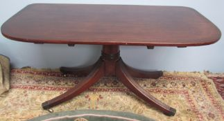 """A Regency mahogany table section of """"D"""" outline on a ring turned column and four reeded legs with"""