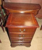 A reproduction mahogany half moon side table together with a bedside chest.
