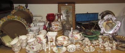 A collection of Limoges porcelain miniatures together with a glass dressing table mirror,