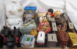 Twenty four assorted pottery and metal money boxes etc