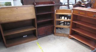 An ash bureau with bookcase base together with two other oak bookcases,