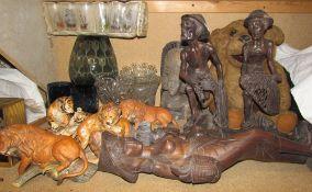 Carved Balinese figures together porcelain lions, glass bowls,