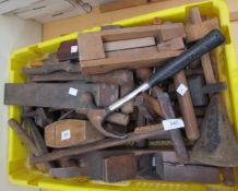 A large collection of tools including planes, saws,