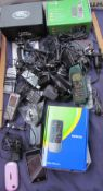 Assorted mobile phones and charging cables,