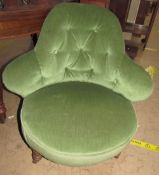 A Victorian button back upholstered nursing chair on fluted legs and casters