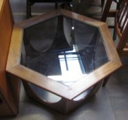 A mid 20th century teak and glass coffee table of hexagonal form with shaped legs on a plinth base