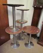 Assorted pub tables with circular tops and chrome columns