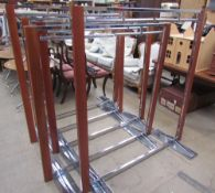 A set of five chrome and teak shop clothes rails of varying heights