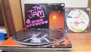 The Caterpillar, The Cure, 1984, together with other records including the Jam, UB40, Talking Heads,