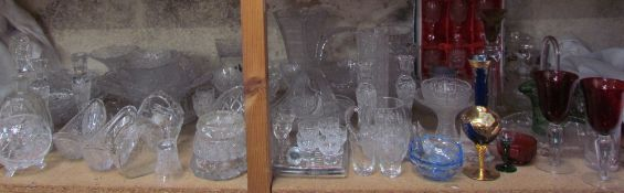 A large collection of Bohemian glass wares including vases, drinking glasses, bowls, dishes,