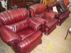 A red leather three piece suite,