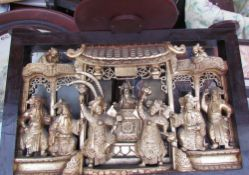 A Chinese carved panel depicting figures in an interior together with a nest of tables,