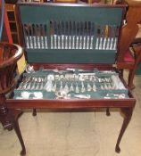 An electroplated Kings pattern flatware service contained in a reproduction mahogany side table on