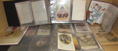A collection of postcards in albums