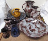 A Ewenny pottery puzzle jug, made by Caitlin Jenkins, together with Ewenny pottery dishes, jugs,
