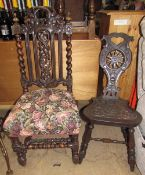 A carved oak spinning chair decorated with flowerheads and leaves,