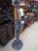 An Armillery Sundial with arrow pointer on a cast iron column