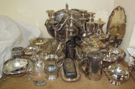 An electroplated four piece tea set together with a pair of candleabra, trays,