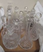 A collection of crystal decanters of various shapes and sizes