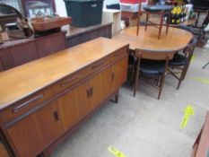A G-Plan teak dining suite, comprising an extending dining table,