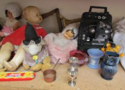 A Bell & Howell projector, Model 256 EX together with dolls, toys, brass wares, pottery jugs,