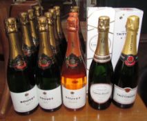 A bottle of Laurent Perrier champagne together with a bottle of Taittinger champagne,