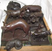 Heredites models of animals together with a cast iron bull, pottery rhinocerous,