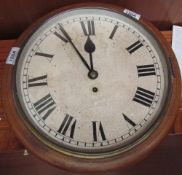 A railway type timepiece with a circular dial and Roman numerals