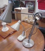An angle poise desk lamp together with another lamp