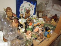 A collection of Country Artists models of birds together with a glass decanter, brandy glasses,