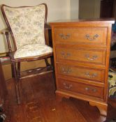 A mahogany bedside chest with four drawers on bracket feet together with an elbow chair