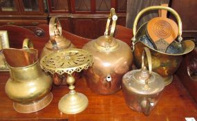 A copper kettle together with a brass coal scuttle, other copper kettles, brass trivet,
