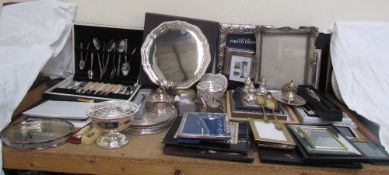 A Mappin and Webb electroplated salver, together with a collection of photograph frames,