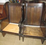 A pair of mid 20th century stained oak elbow chairs